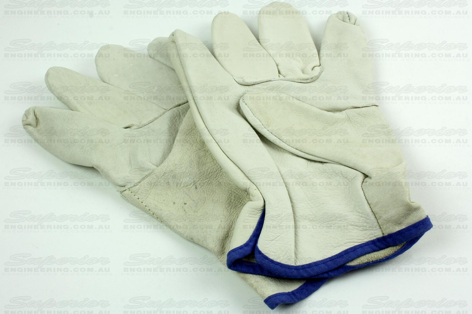 Pair of leather safety gloves that come standard in the T-Max kit