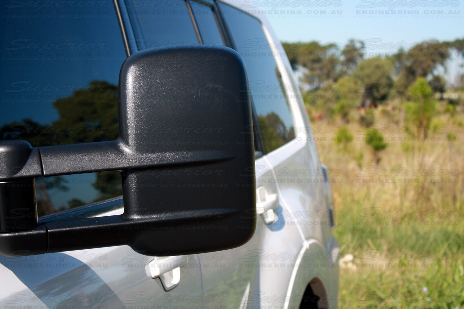 Left front view of a black Mitsubishi Pajero Clearview Towing Mirror