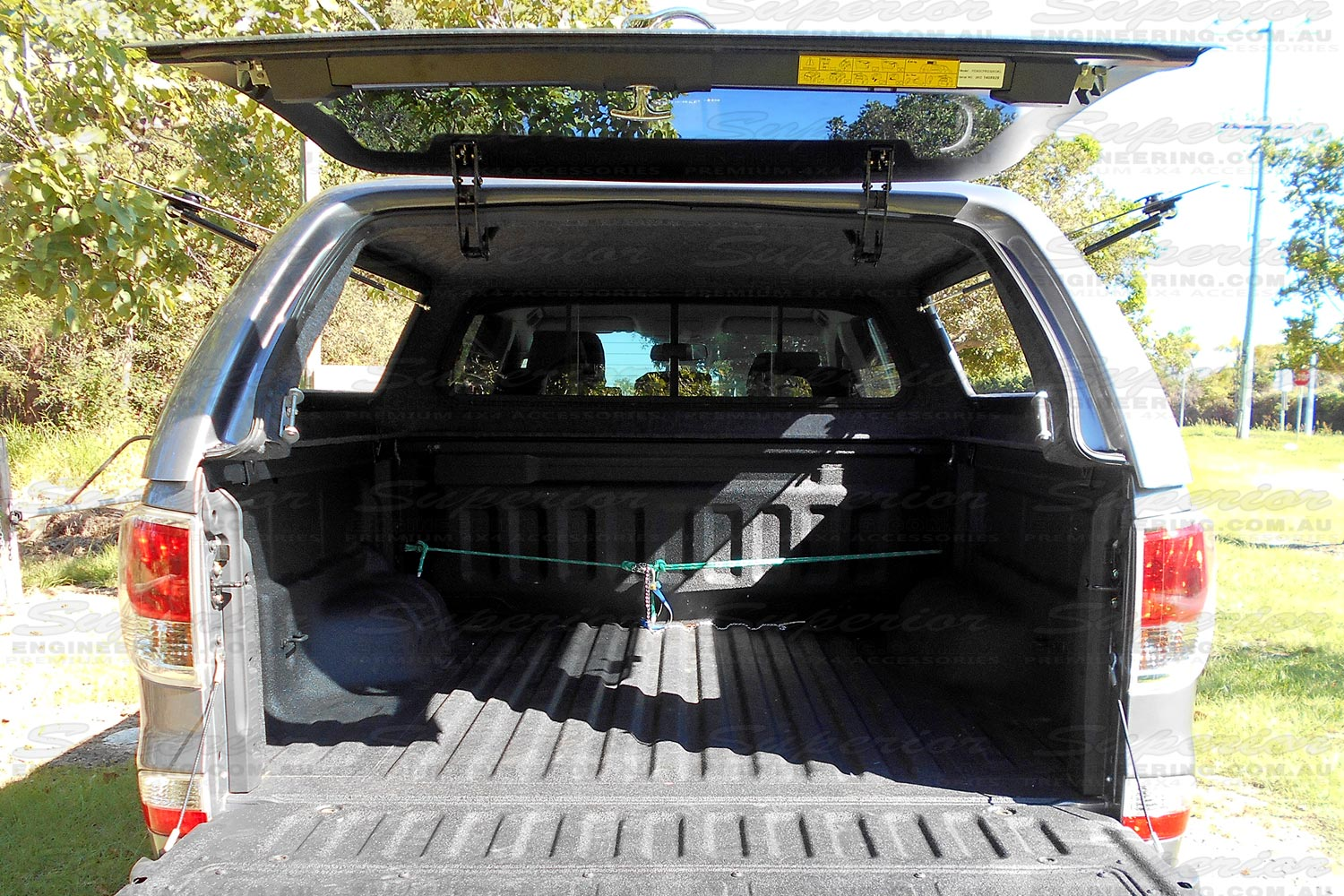 Rear view of the Ironman 4x4 Thermoplas Canopy with the rear window fully open and tray down