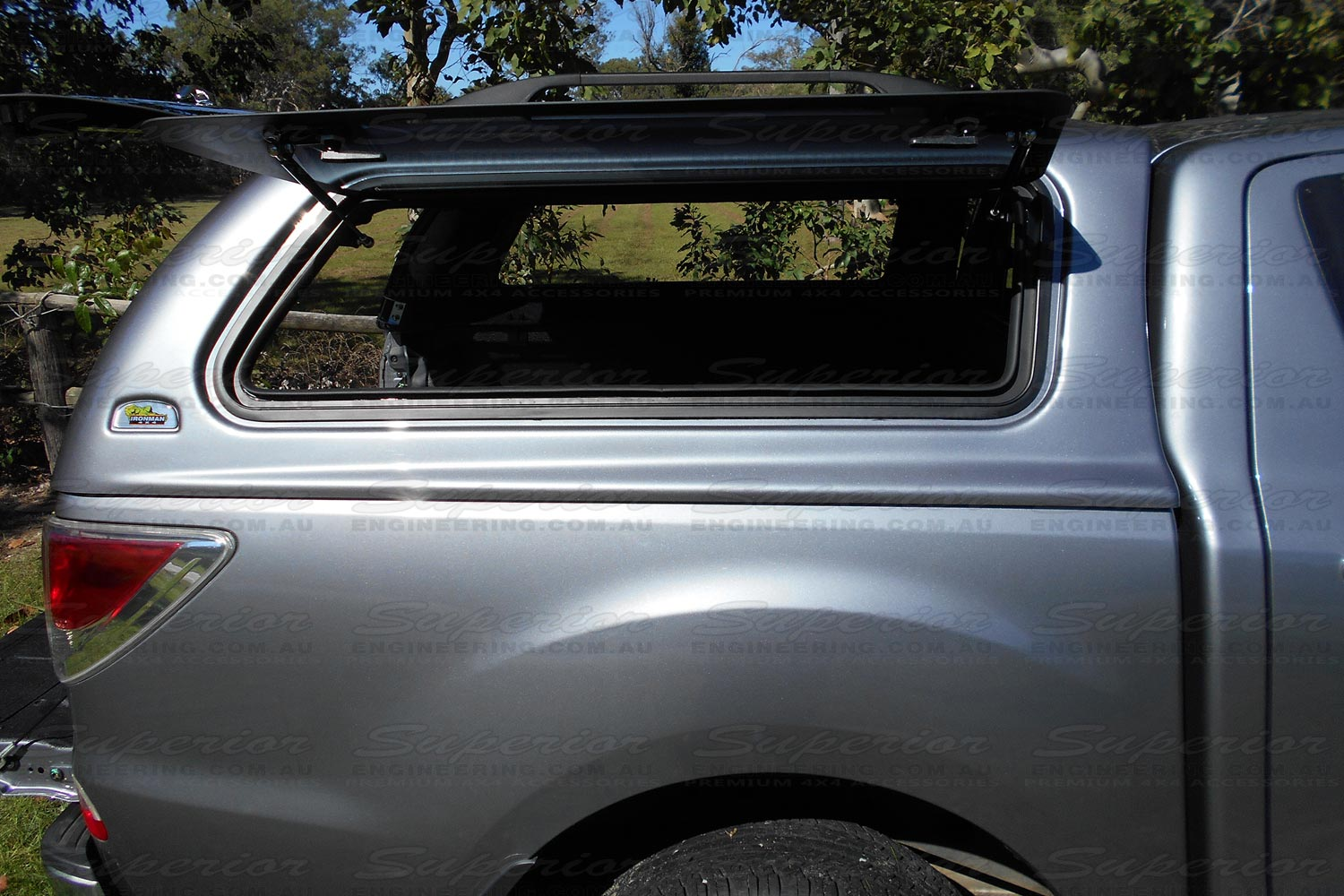 Right side window of the Ironman 4x4 Thermoplas Canopy fully opened while mounted to the Mazda BT-50