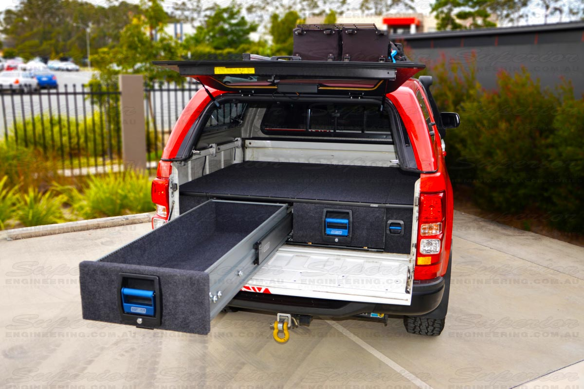 Rear view of a current model Holden Colorado with the MSA 4x4 Drawer System fitted with one drawer open showing all the storage area available in the draw