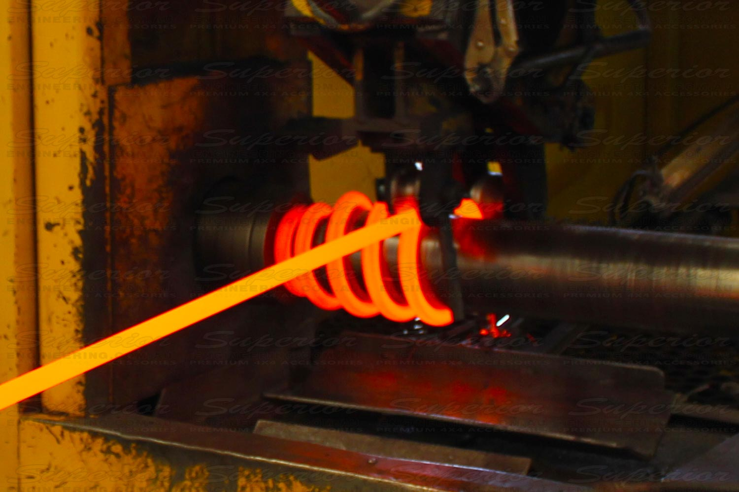 The beginning stage of a coil spring being wound and formed on our precision mandrels