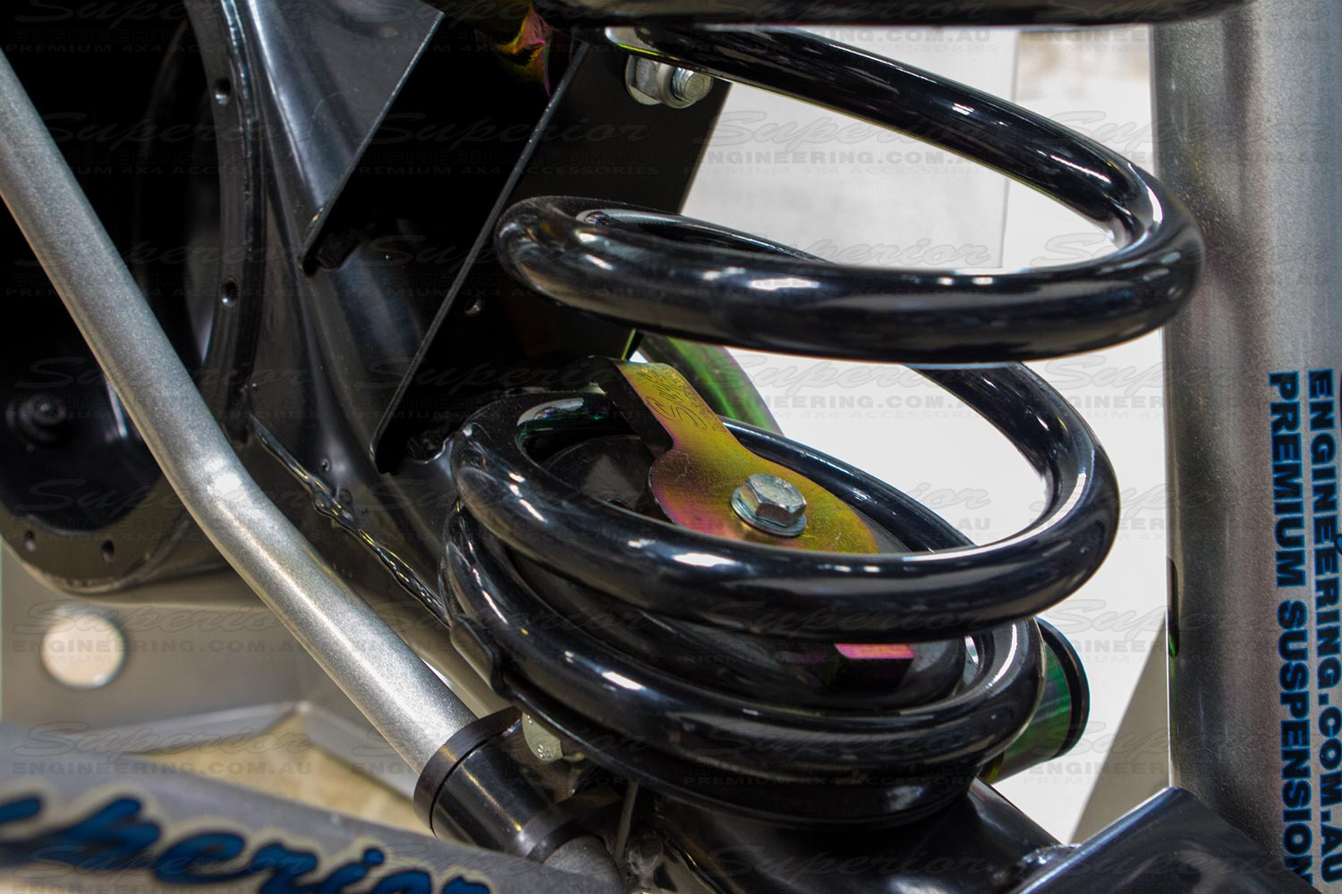 Closeup view of the Coil Retainer installed and fitted to the chassis display diff holding down a black coil spring