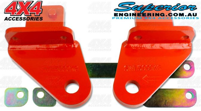 A complete heavy duty NP300 rated towing point kit and the bracket spacers on a plain white background